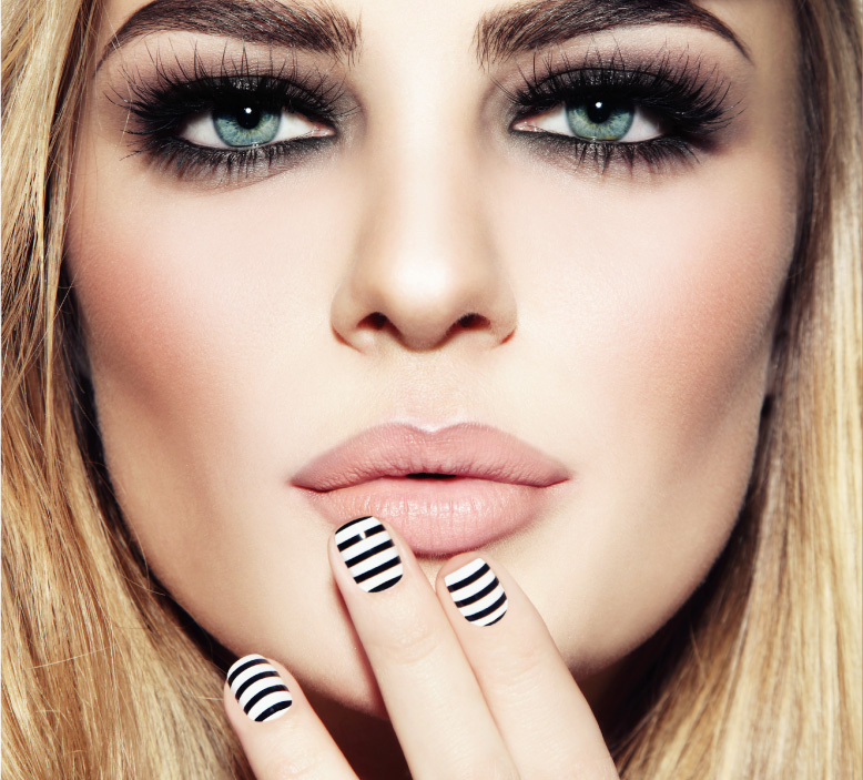 Beautiful woman with immaculately styled nails.