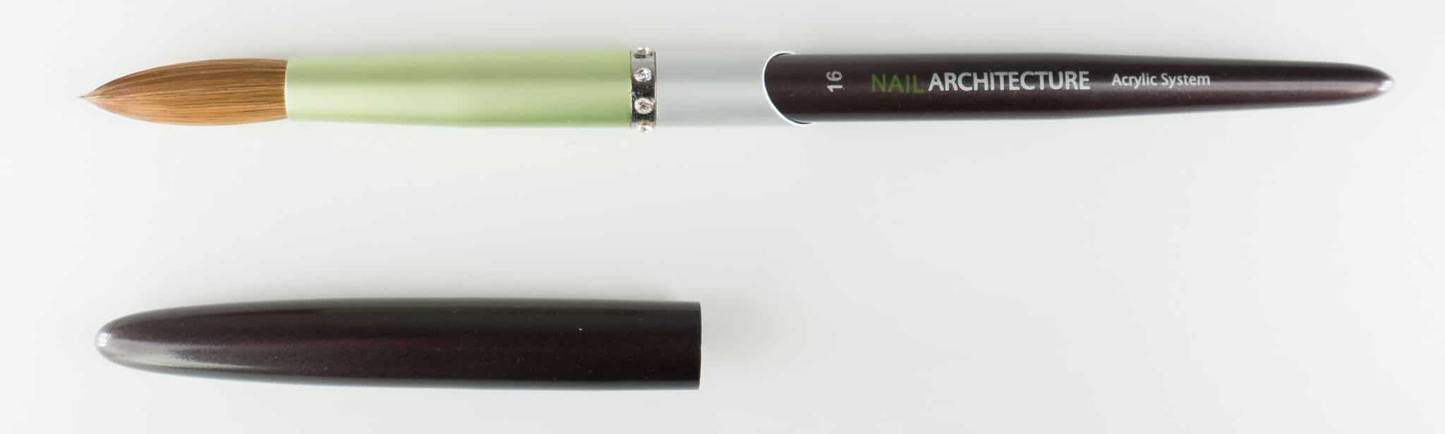 Nail Architecture size 16 pencil brush with cap next to it