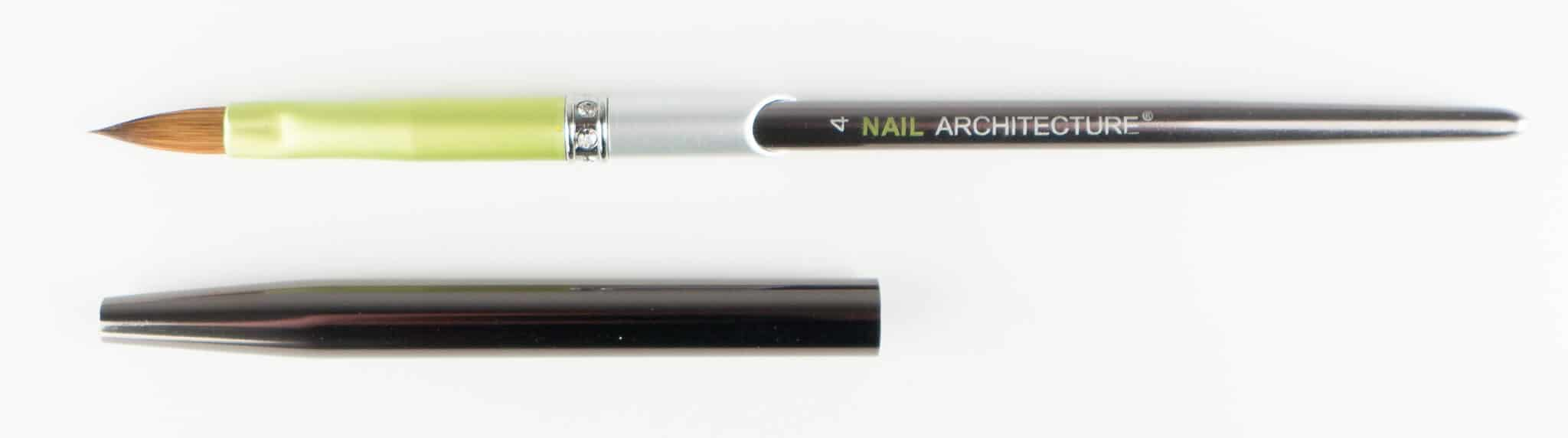 Nail Architecture size 4 pencil brush with cap next to it