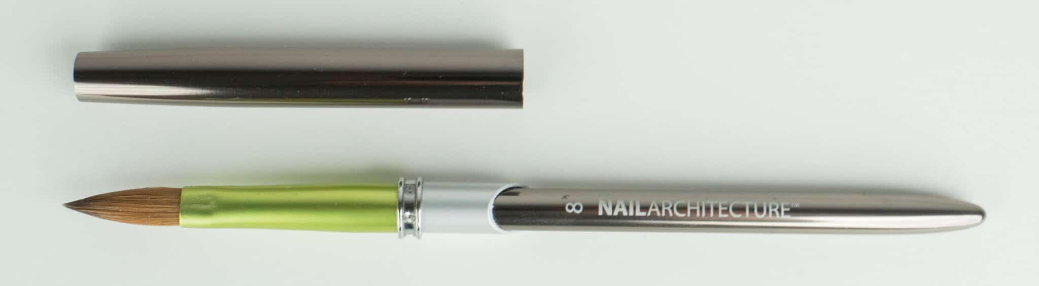 Nail Architecture size 8 pencil brush with cap next to it