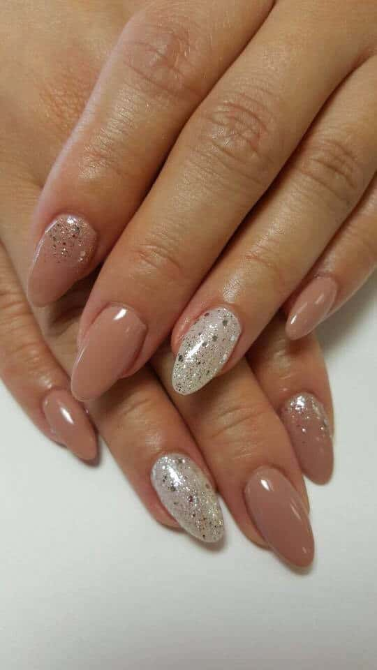 beige nails with silver decorations.