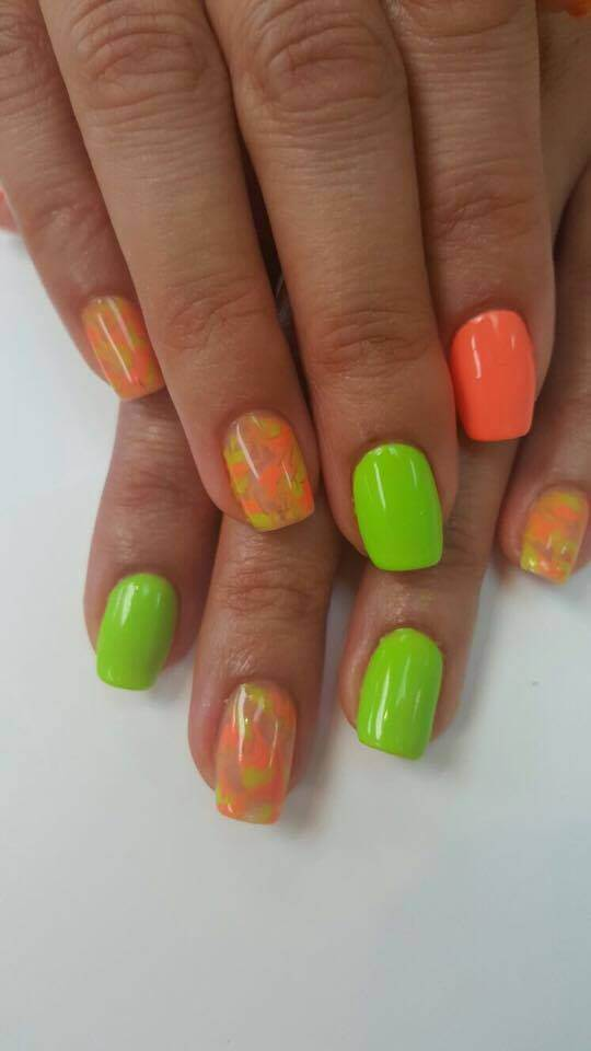 bright orange and green nails.