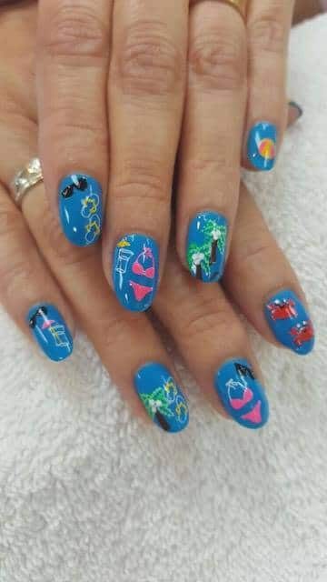 beach-themed blue nails.