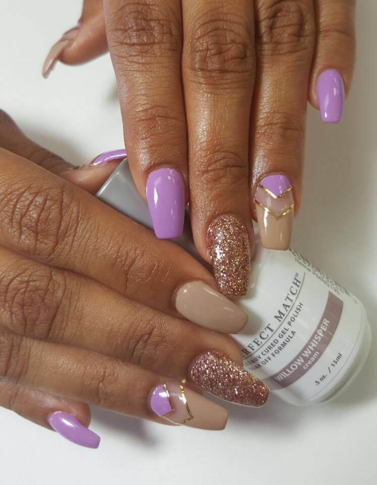 hands holding bottle of Perfect Match Willow Whisper, nails painted light purple and beige with golden details and glitter.