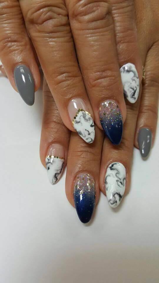 set of blue, white and grey nails.