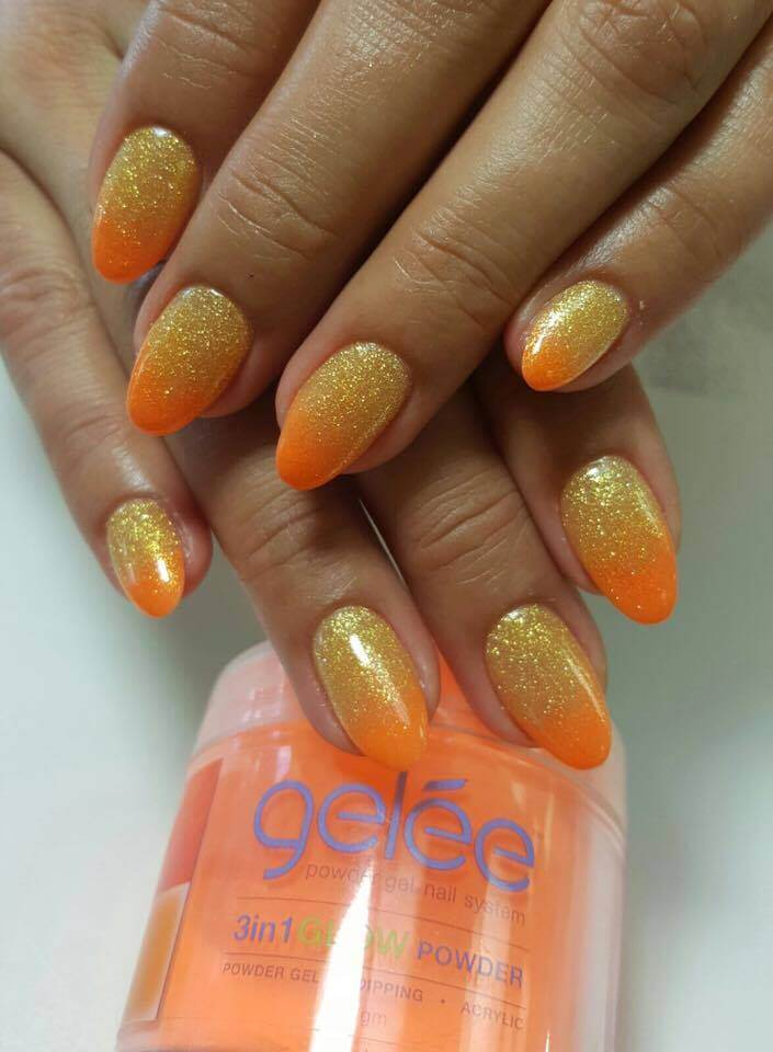 set of yellow and orange sparkly nails.