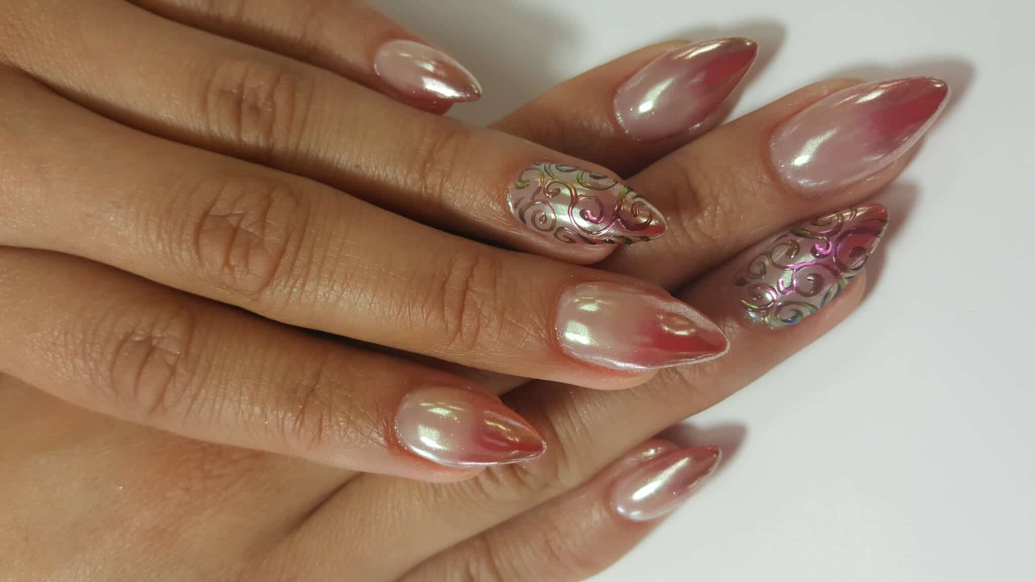 set of red and gold nails.