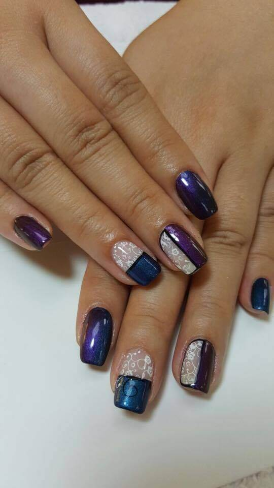set of purple and blue nails with white details.