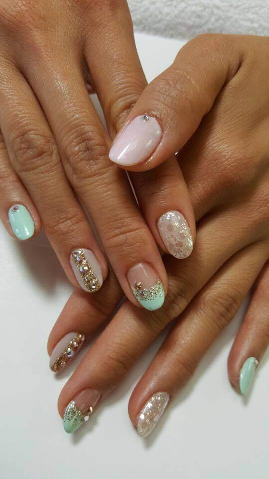 set of mint and cream colored nails.