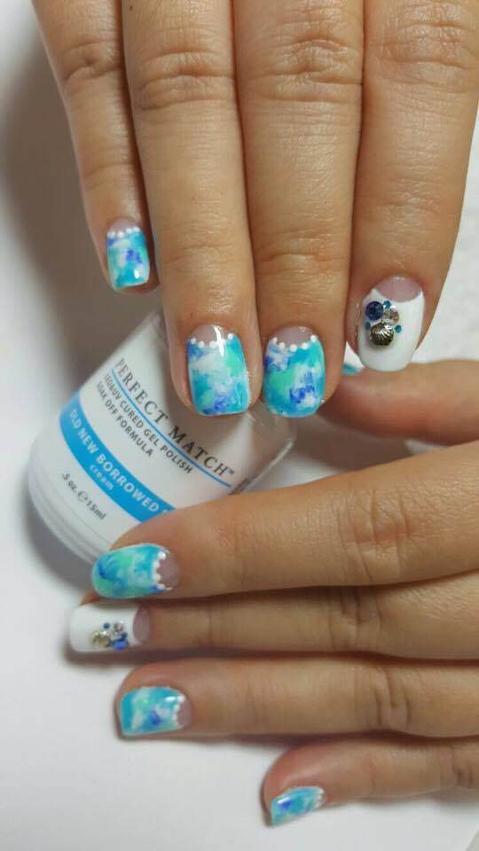Ocean-themed nails using Old New Borrowed Blue.