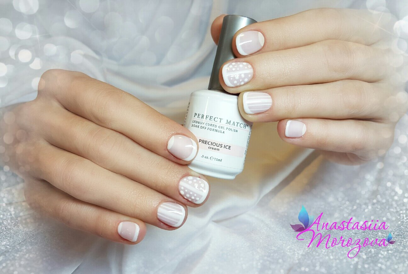 hands holding bottle of Perfect Match precious ice, nails decorated with white stripes and dots, art by Anastasiia Morozova.