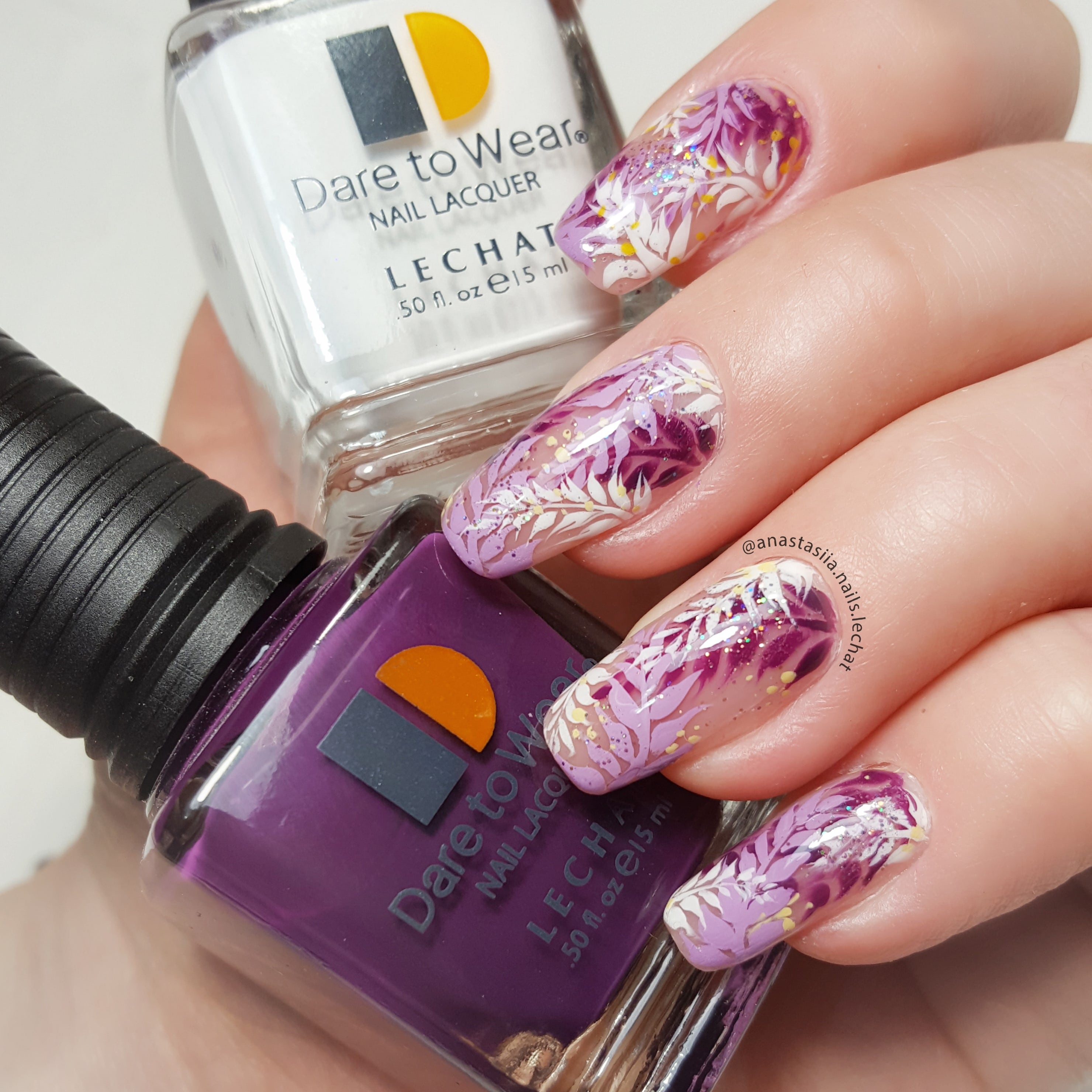 Dare to Wear nail art with purple and white flowers