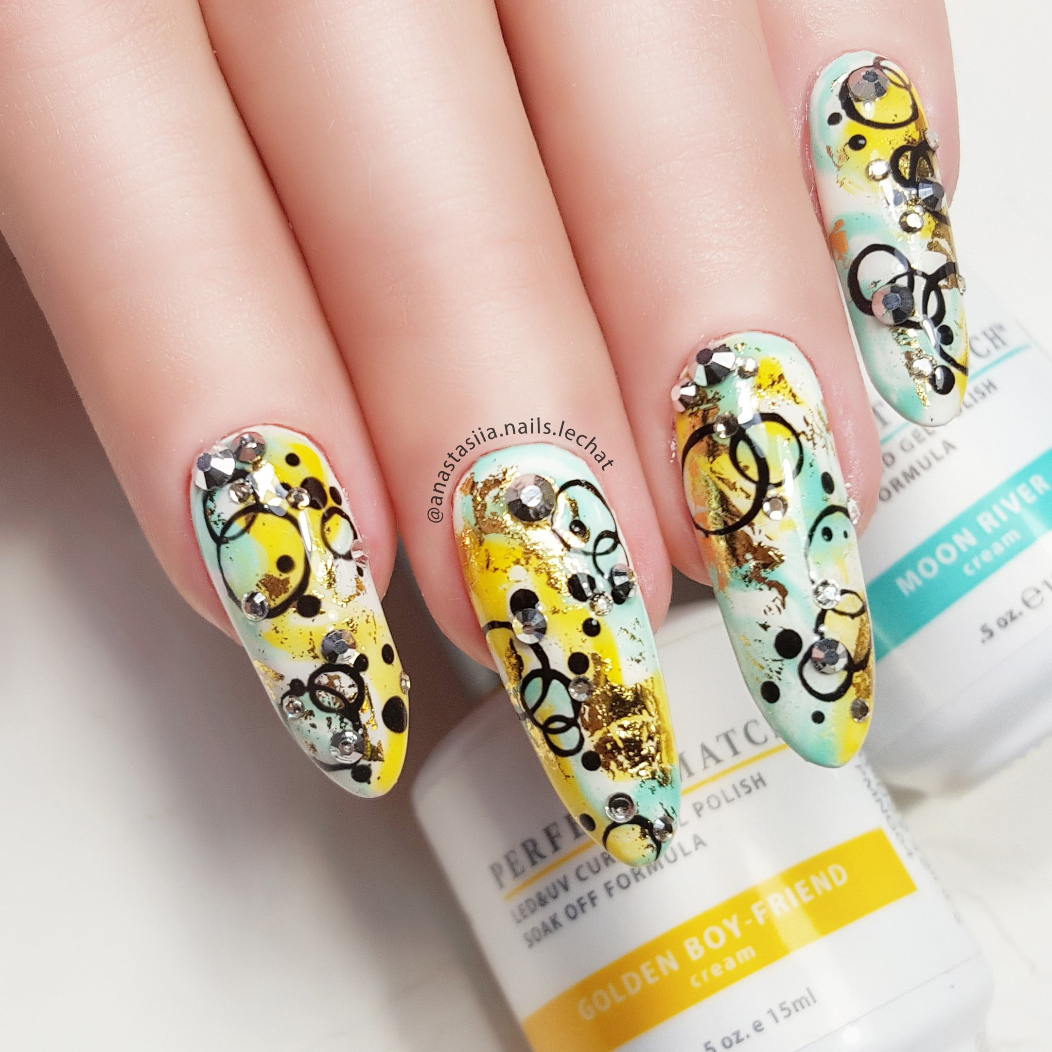 nail art with black, yellow and blue colors
