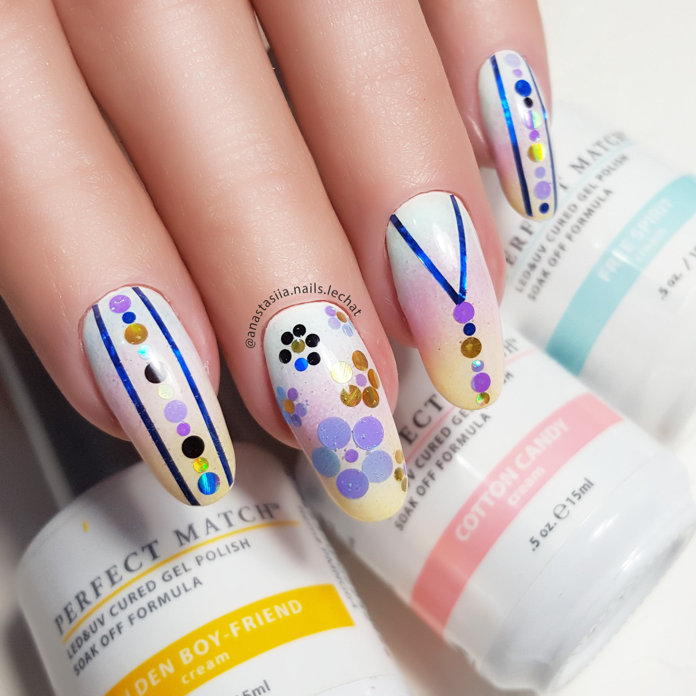 colorful nail art with shades of blue and gold
