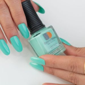 Two hands holding LeChat's Dare to Wear nail polish in color Teal Me About It