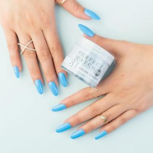 Two hands holding LeChat Perfect Match DIP in color Blue-tiful Smile