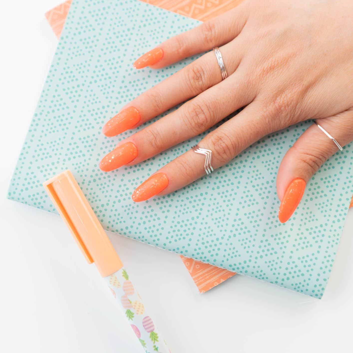 orange nails with glitter effect