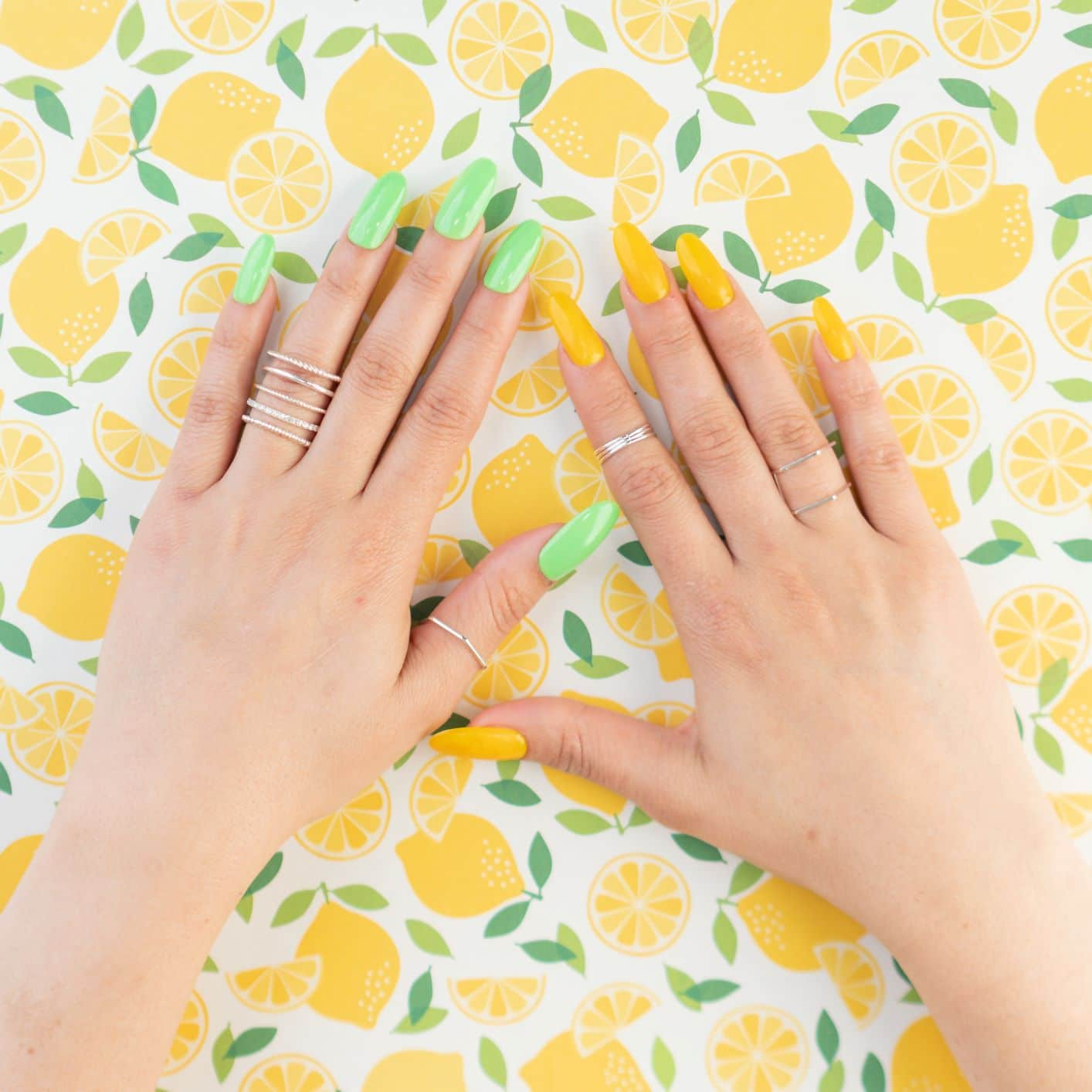 pair of yellow and green nails