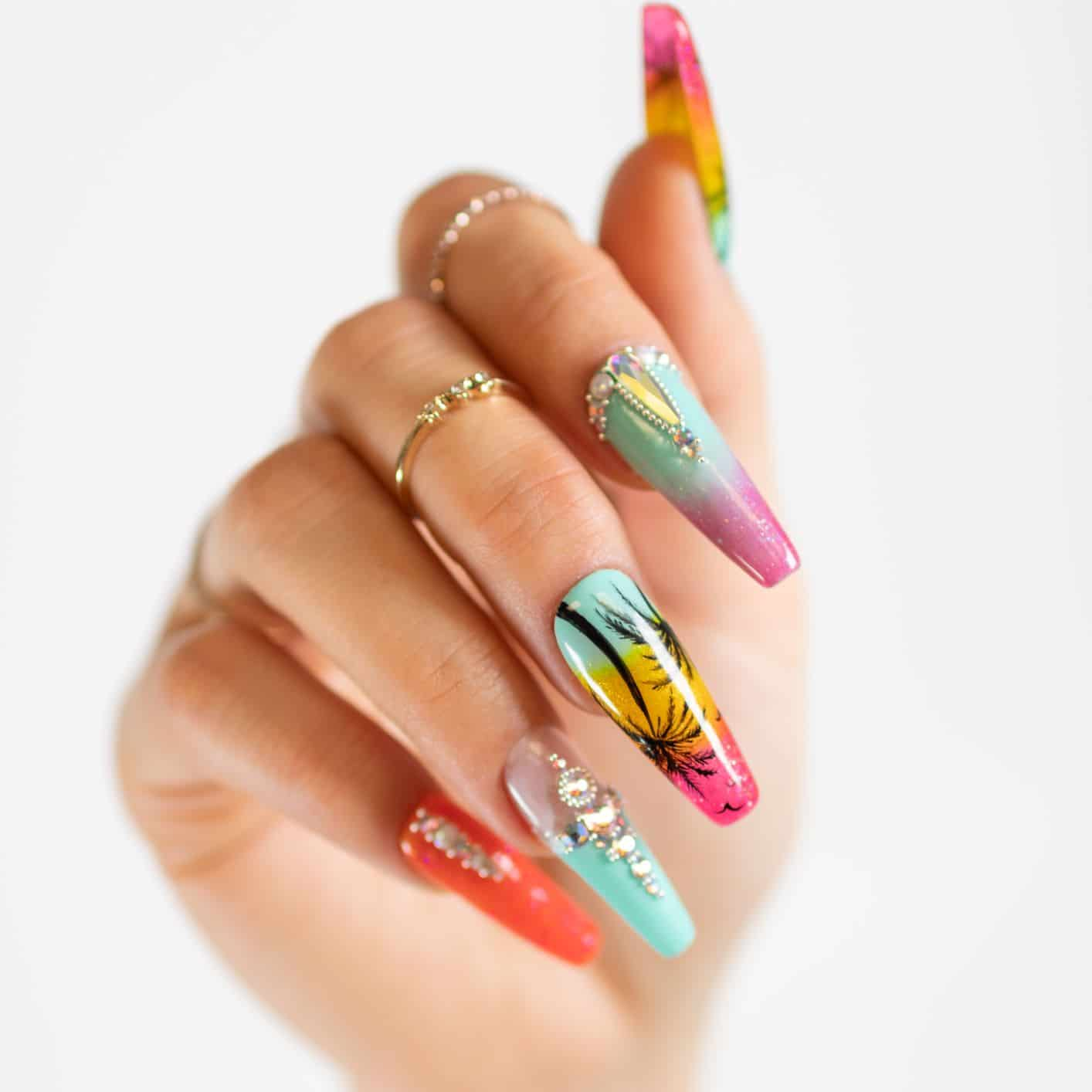 close-up of palm tree art on nails