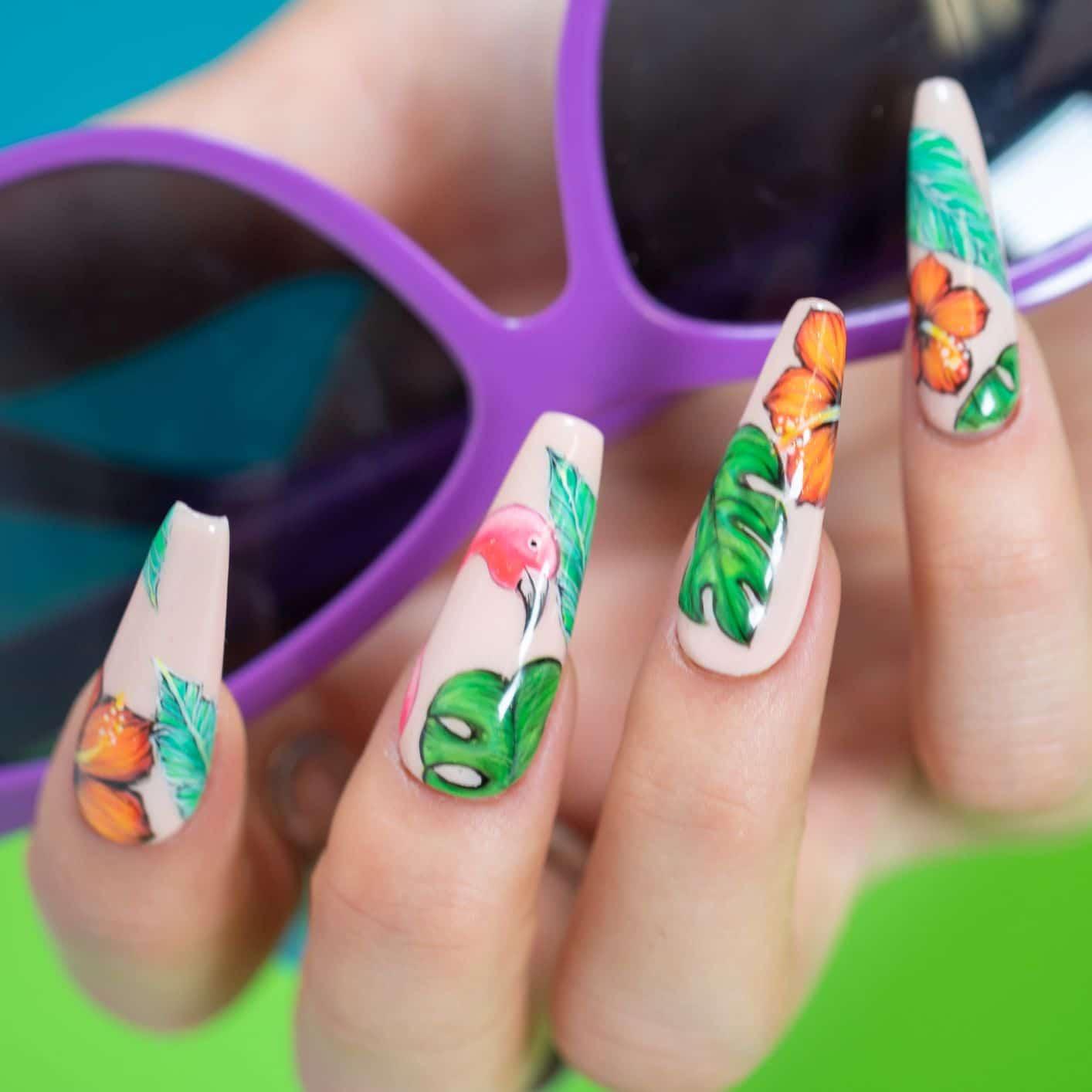 close-up of flamingo art on nails