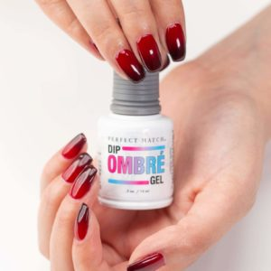Dip ombre on hands with red nails