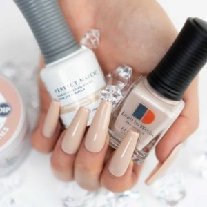 hand holding bottle of tan lacquer and gel, nails decorated with the shade