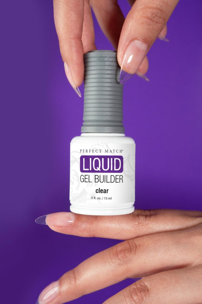 Hands holding bottle of liquid gel builder