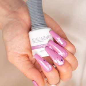 Hand with long pink nails using Lilac Lux PM267