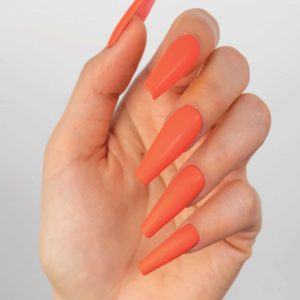 Hand with long orange nails using Shattered Sun PM270