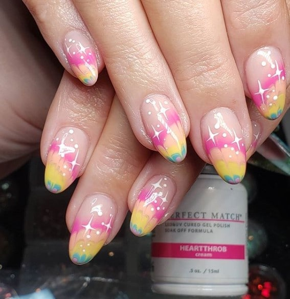 multicolored rainbow nails with a tie-dye design