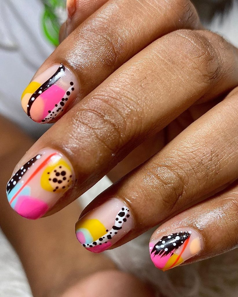 bright colorful short nail design with negative space