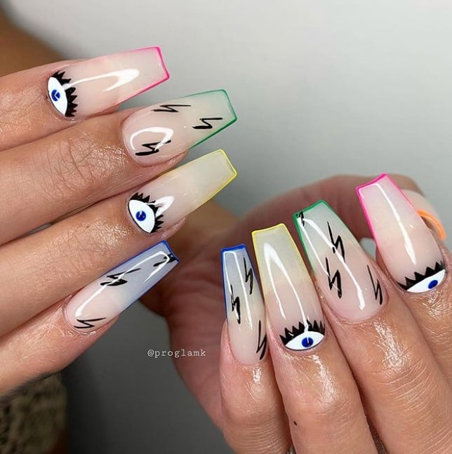 Clear base nails with abstract art in pink, green, yellow, blue, black, and white