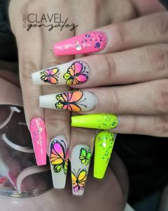 bright butterfly nails in front of uv led incure lamp