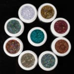 The SkyDust Jars viewed from top with their lids off, showing the vibrant and shiny colors.