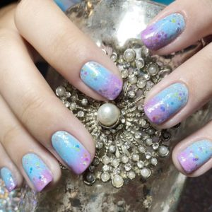 DIY Pastel Ombre Nail Design, light blue to pink ombre with a translucent glitter top coat