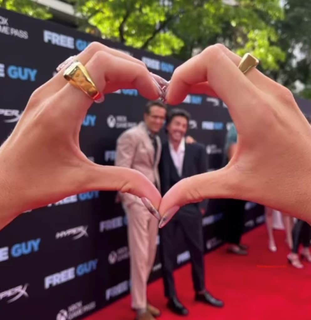 red carpet blake lively, holding hands in a heart shape, showing off nails