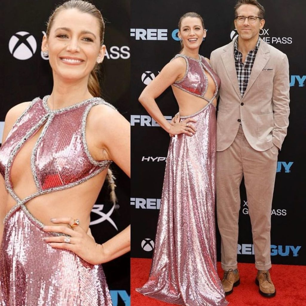 red carpet blake lively, showing off nails, in a sequin pink dress, posing with husband ryan reynolds